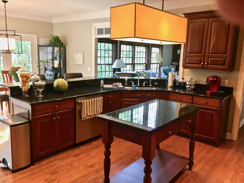 OUTDATED KITCHEN WITH DARK CHERRY CABINETRY IN NAPERVILLE IL.