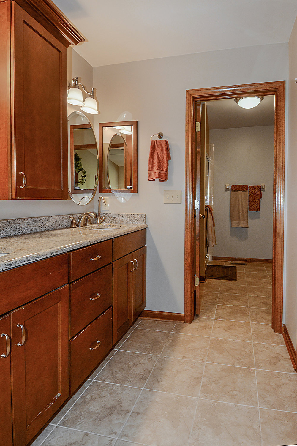 New Tile Floors in this Naperville IL End Unit Townhome Bathroom Remodel. New Trim & Double Bowl Vanity Also. Naperville IL. Townhome Remodeling & Updating.