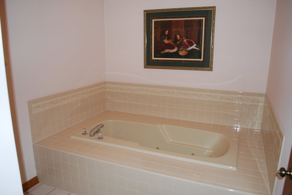 Yikes Look at that Tub Deck!  It is So Big You Can Barely Climb into the Tub!  Yank that Old Tub Out!  New Buyers do Not Want them or they want Freestanding Tubs with NO Jets!  It is Very Hard to Clean the Jets and they Grow Bacteria and Mold…