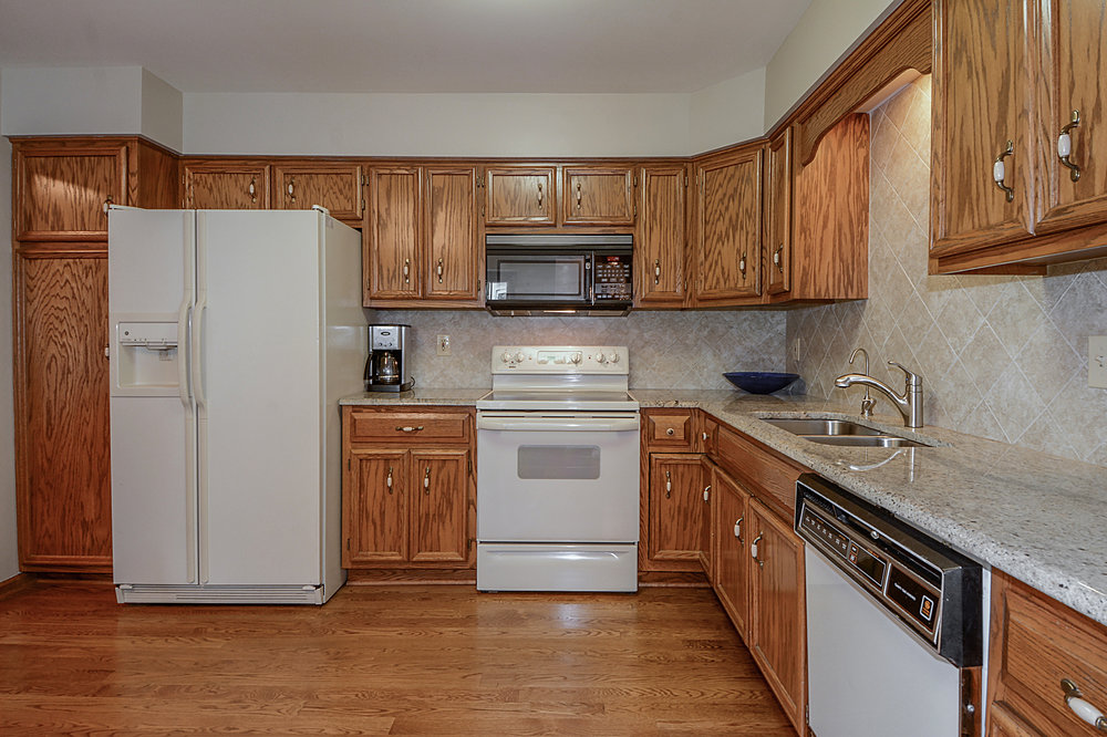 Naperville IL. Townhome Kitchen Updating with Granite & New Backsplash. New Hardwood Flooring & Faucet.  Looking to Update Your Townhome Before You List for Sale?  Call Southampton