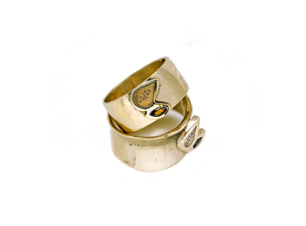 TWO LEAVES RING |   14 karat yellow gold Baha'i rings with bezel set marquise andulasites, and laser engraved Ringstone Symbol relief.