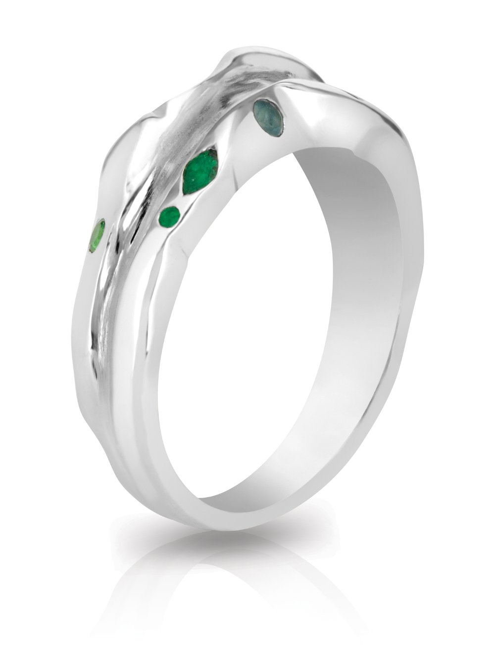 TRAIL RING | silver ring with polished edges and matte recess with flush set emeralds, tourmalines, tsavorites, and alexandrites.