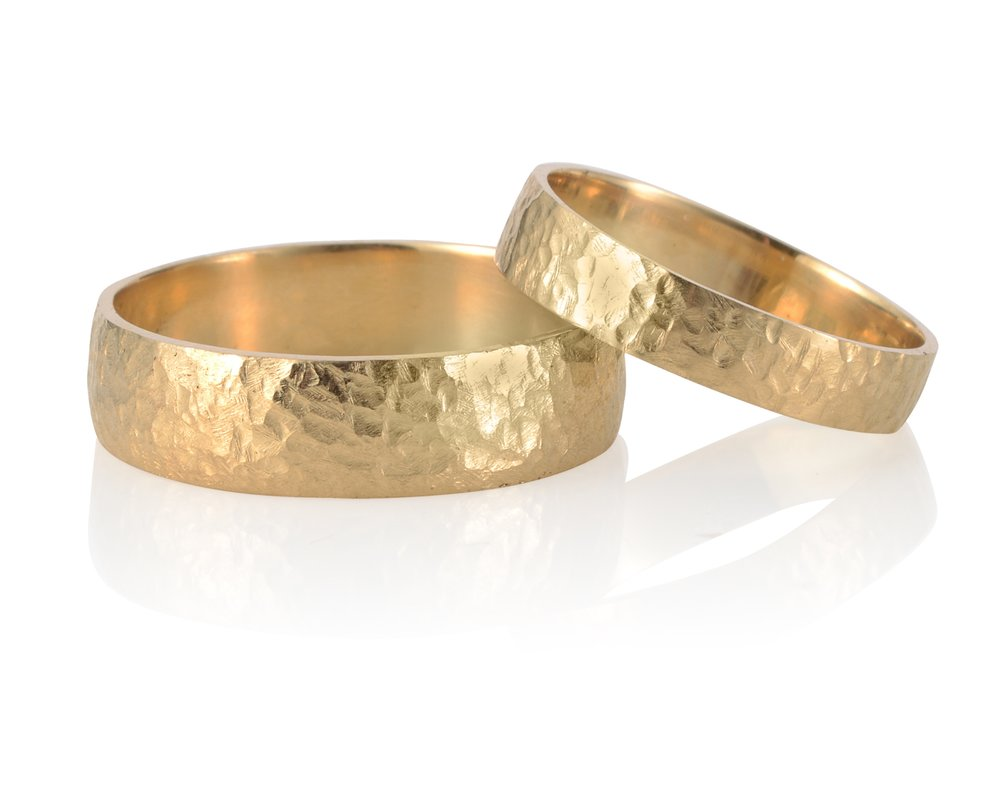 WEDDING BANDS | Hammered wedding bands in 18 karat yellow gold.