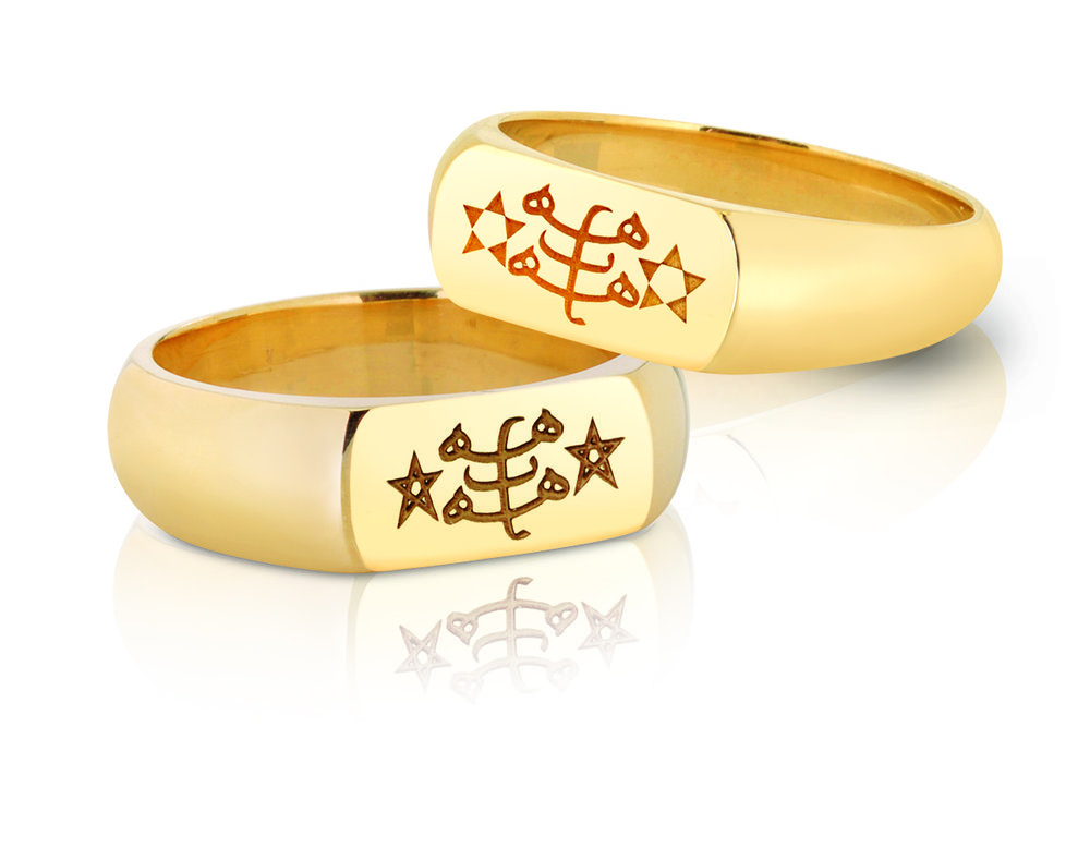 WEDDING BANDS | 10 karat and 14 karat yellow gold bands with laser engraved Ringstone Symbol