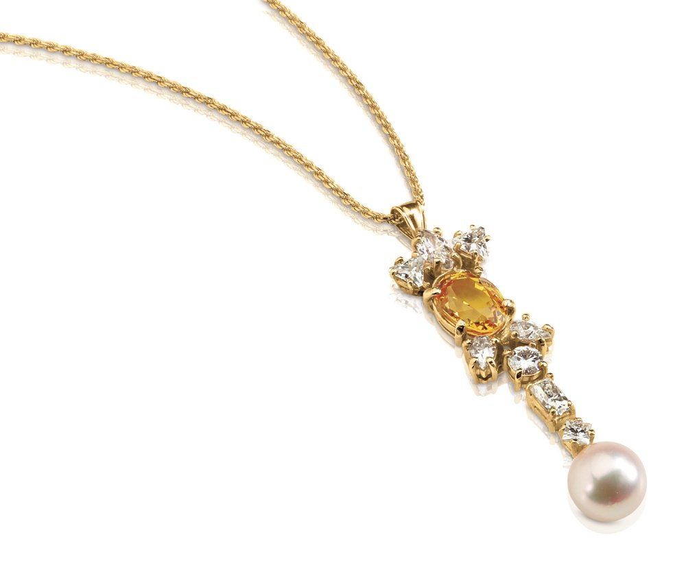 SAPPHIRE PENDANT | 10 karat yellow gold pendant with natural yellow gold sapphire, a cultured 10mm Akoya pearl, and various moissanites in double gallery settings.