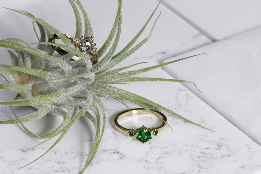 FLORAL RINGS | Delicate 10 karat yellow gold rings with milgrain edges and natural diamonds or tsavorites.