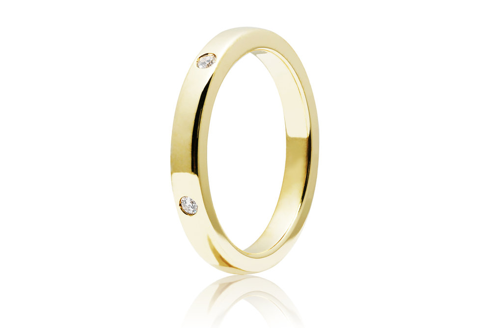 DIAMOND BAND | 10 karat yellow gold band with five natural hearts and arrow diamonds