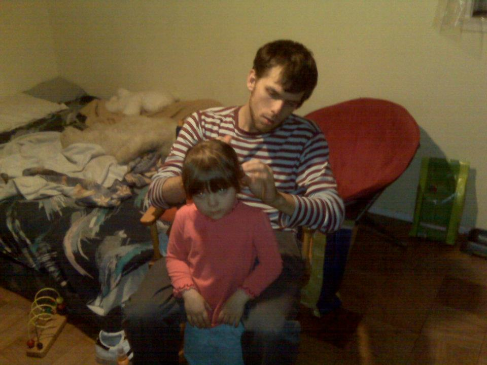 Nate being a good daddy.  October 2009  Baton Rouge, LA, USA