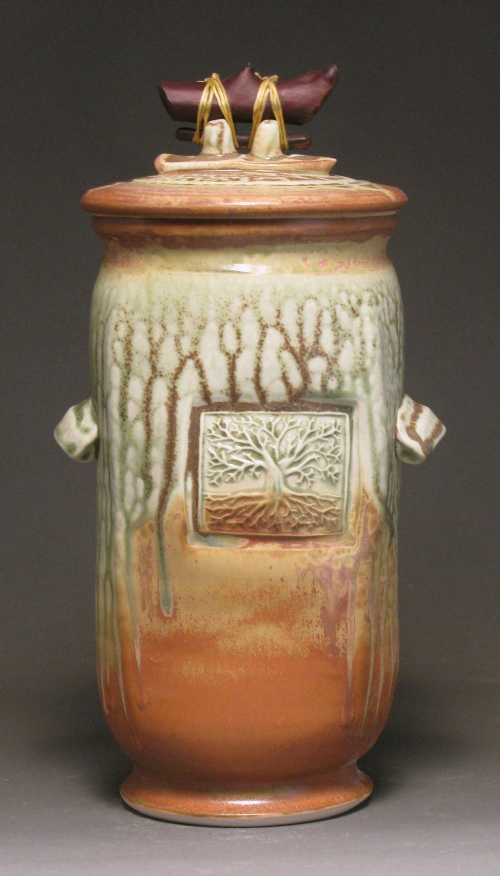 "Lidded jar  9"" tall  Glazes: green ash and matte rust"