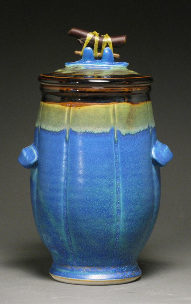 "Lidded jar with manzanita handle 9"" tall Glazes: matte blue and temmoku"