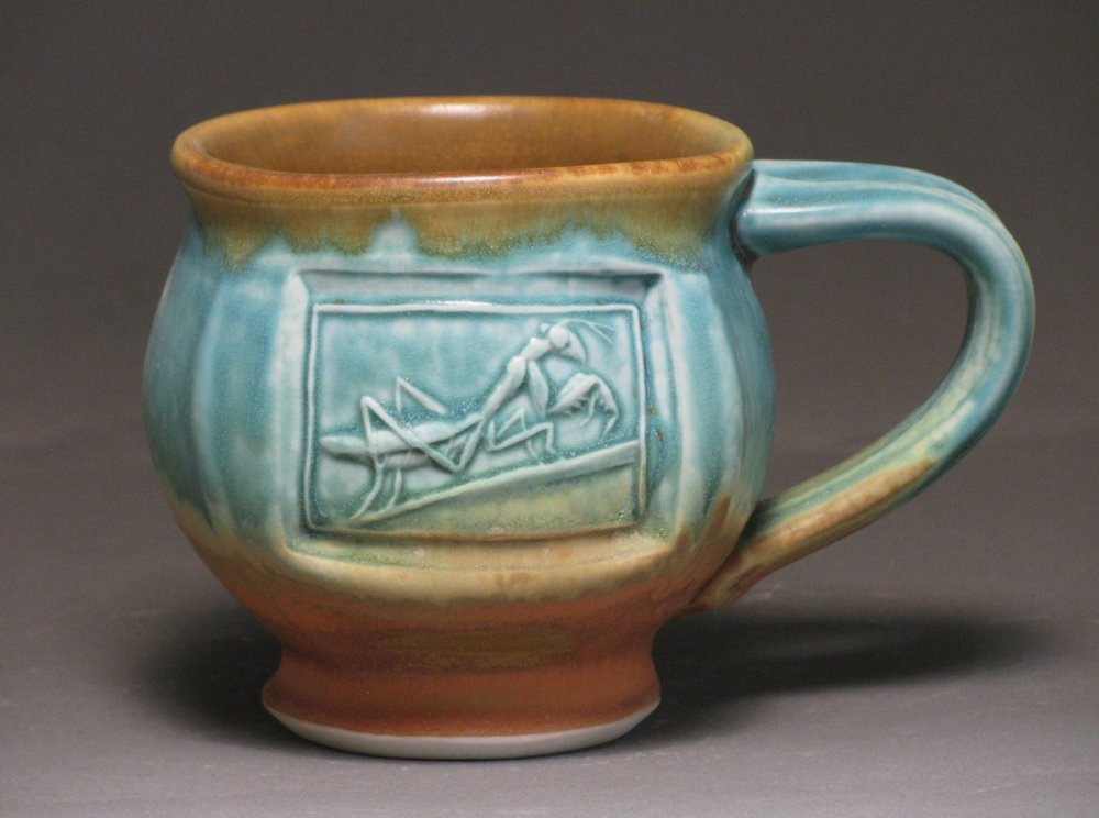 Mug with praying mantis Glazes: matte turquoise and matte rust