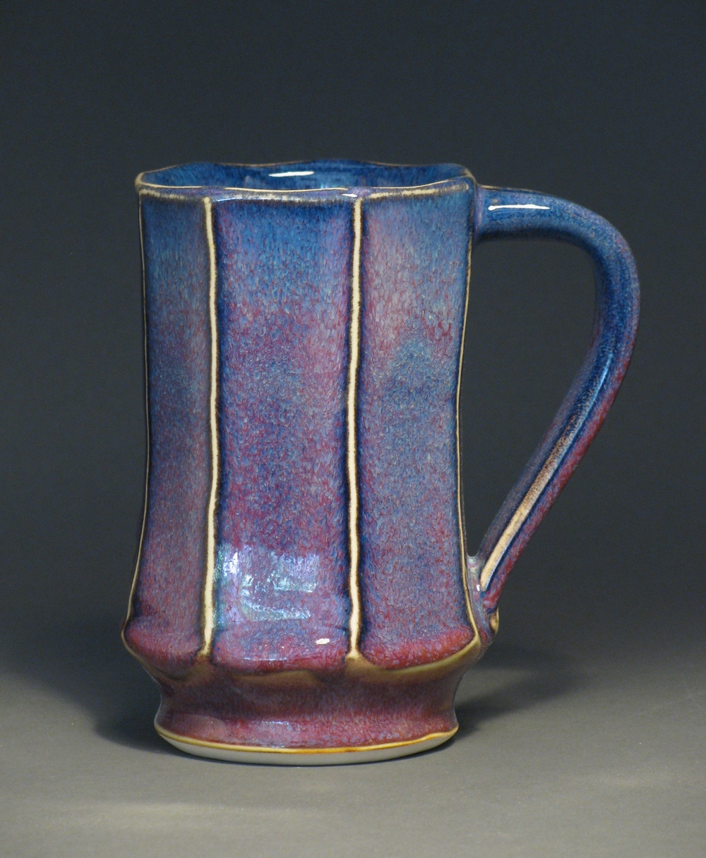 "Facetted mug 5.5"" tall Glazes: purple haze and copper red"