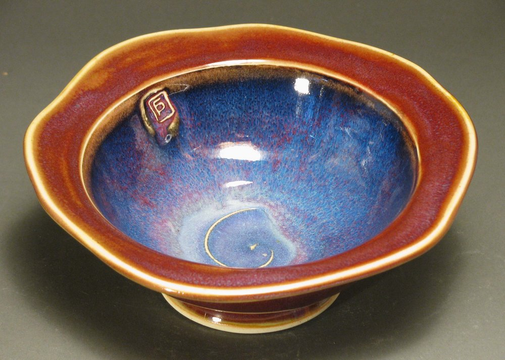 "Soup bowl with cut rim  7.5"" diameter  Glazes: purple haze and copper red"