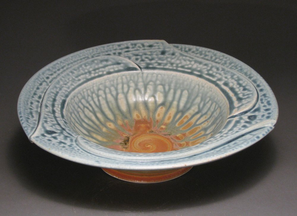"Pinwheel bowl  11"" diameter  Glazes: blue ash and matte rust"