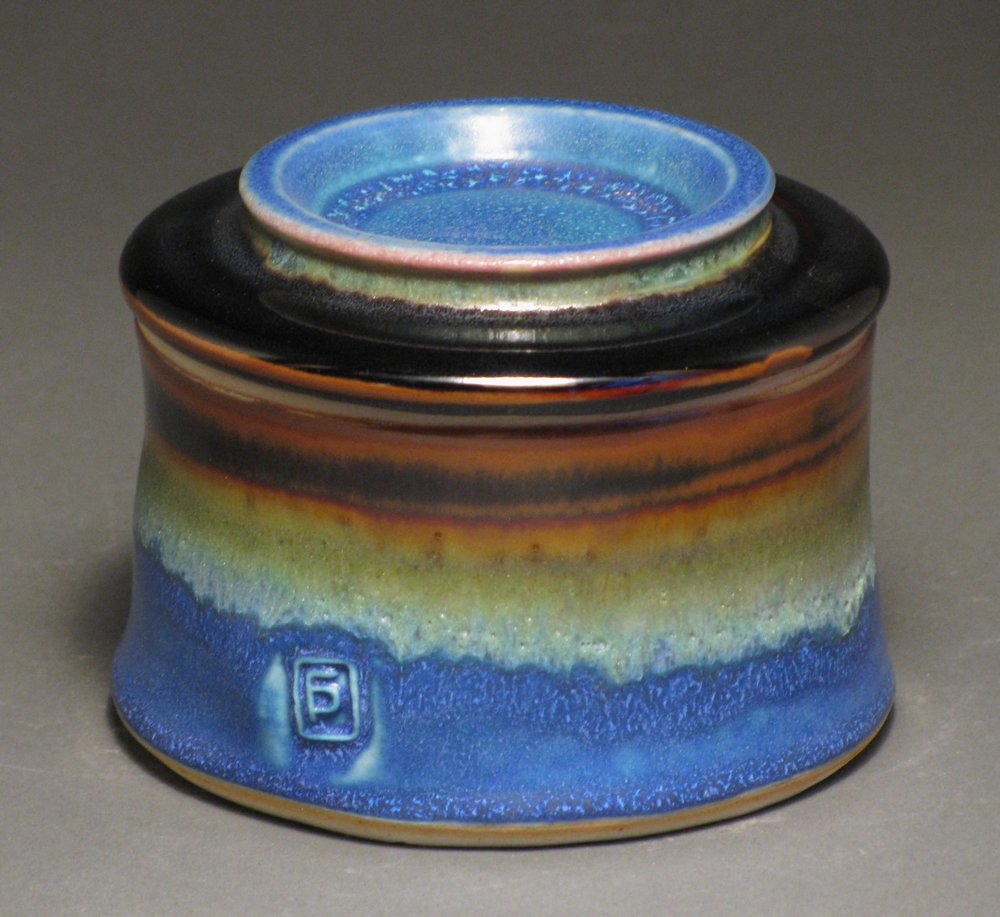 "Butter crock  3"" tall  Glazes: matte blue and temmoku"