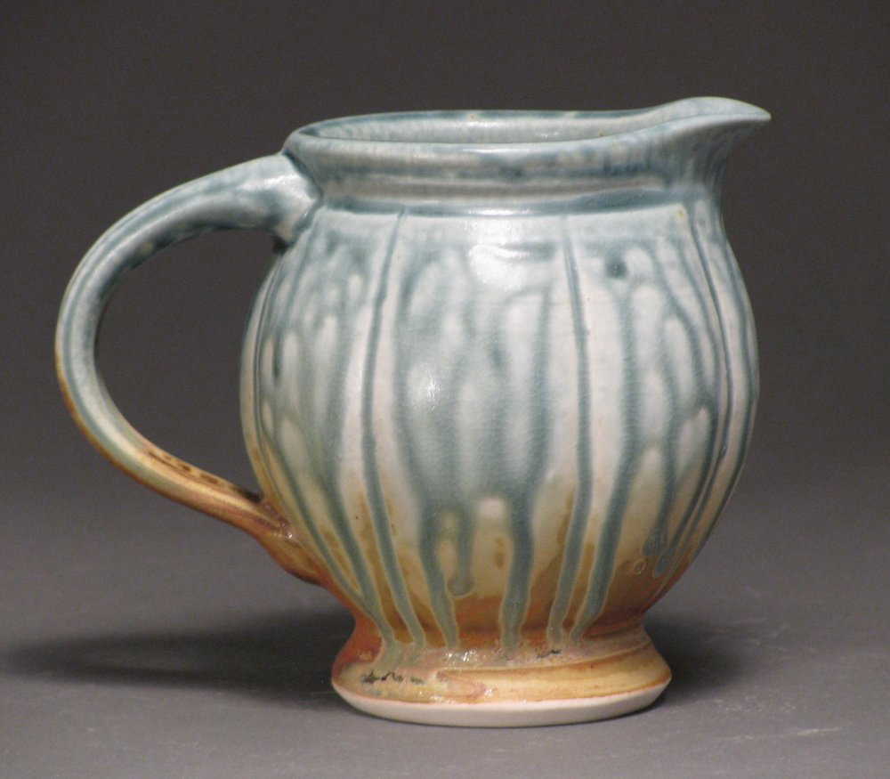 "Creamer  3.5"" tall   Glazes: blue ash and matte rust"