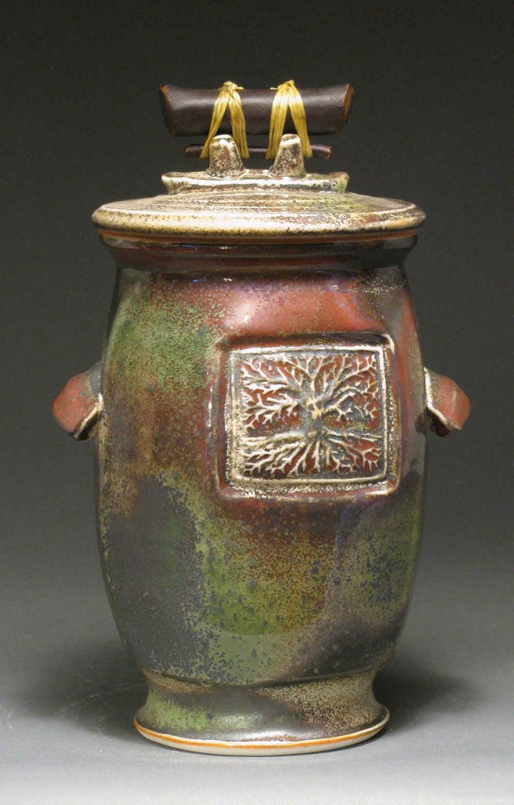 "Lidded jar 10"" tall Glazes: white shino and Rob's green"