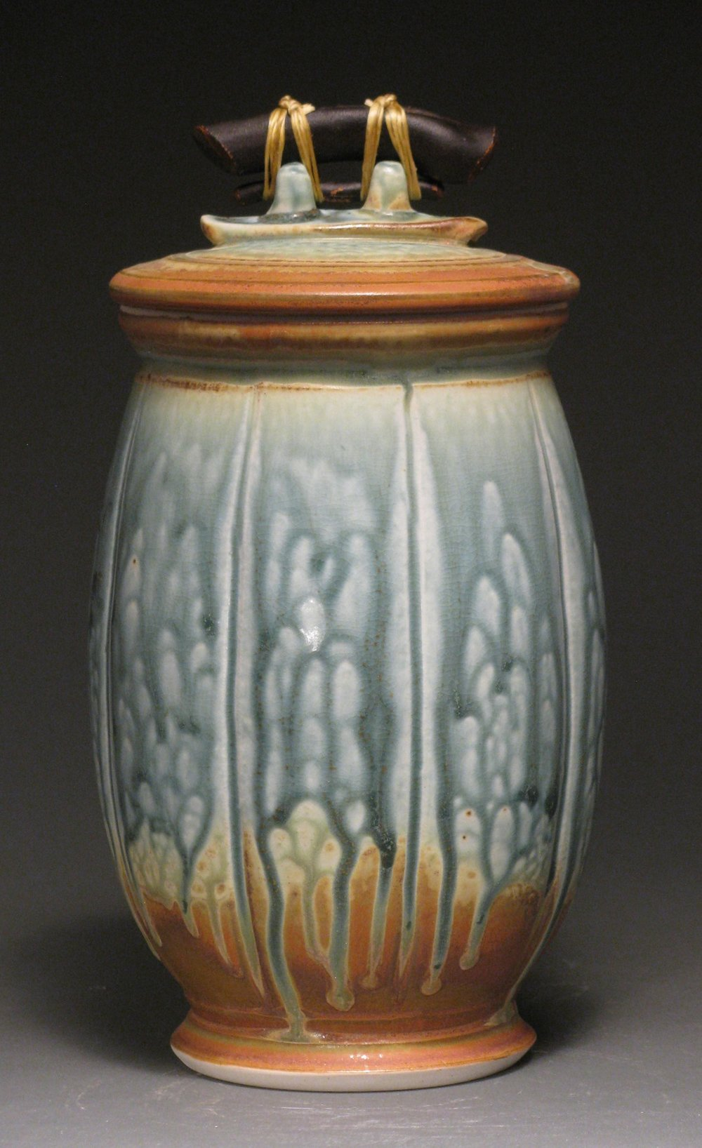 "Lidded jar  10"" tall  Glazes: blue ash and matte rust"