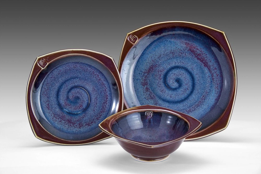 Place setting--squared border  Glazes: purple haze and copper red