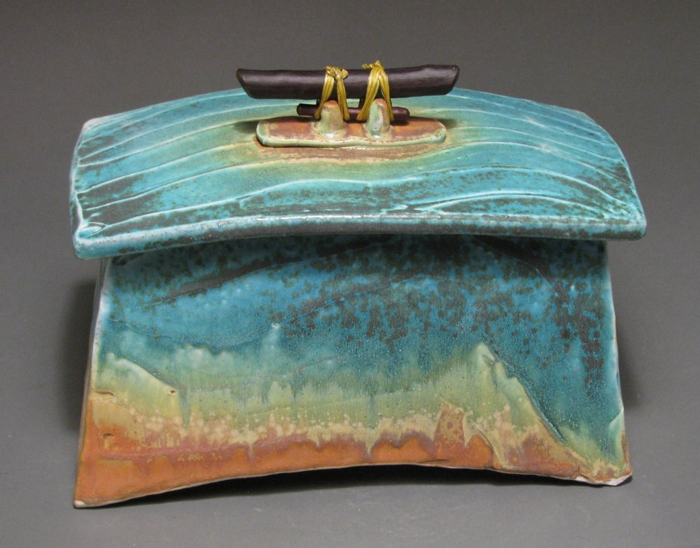 "Lidded box  7"" tall by 10"" long by 5 1/2"" wide  Glazes: Matte turquoise and matte rust"
