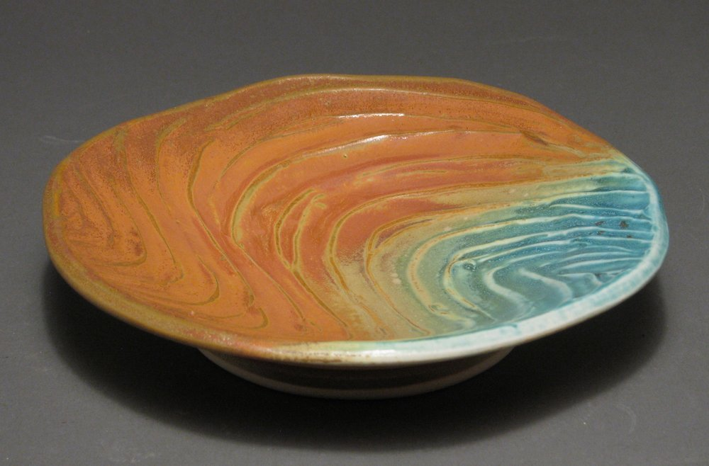 "Plate  8.25"" diameter  Glazes: matte turquoise and matte rust"