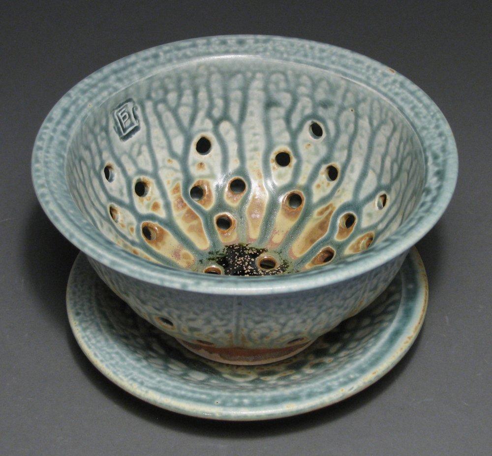 "Berry bowl  7"" diameter  Glazes: blue ash and matte rust"