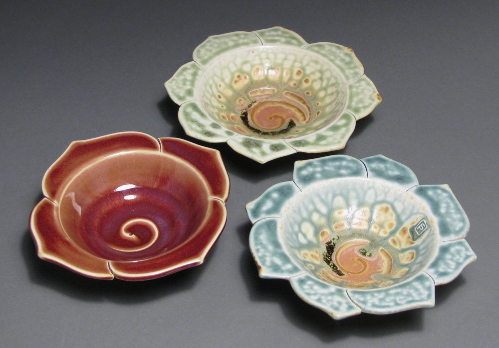 """Lotus dishes  About 6"""" diameter each  Glazes: Copper red; green ash/matte rust; and blue ash/matte rust"""