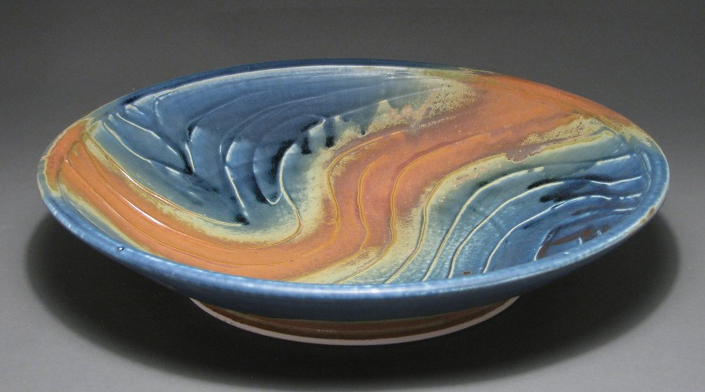 "Serving bowl/platter with slipped texture  15"" diameter  Glazes: Matte blue and matte rust"