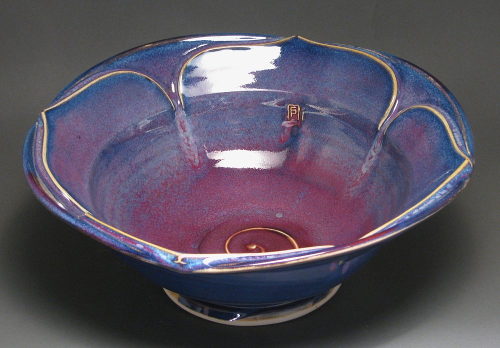 "Lotus bowl  14"" diameter  Glazes: purple haze and copper red"