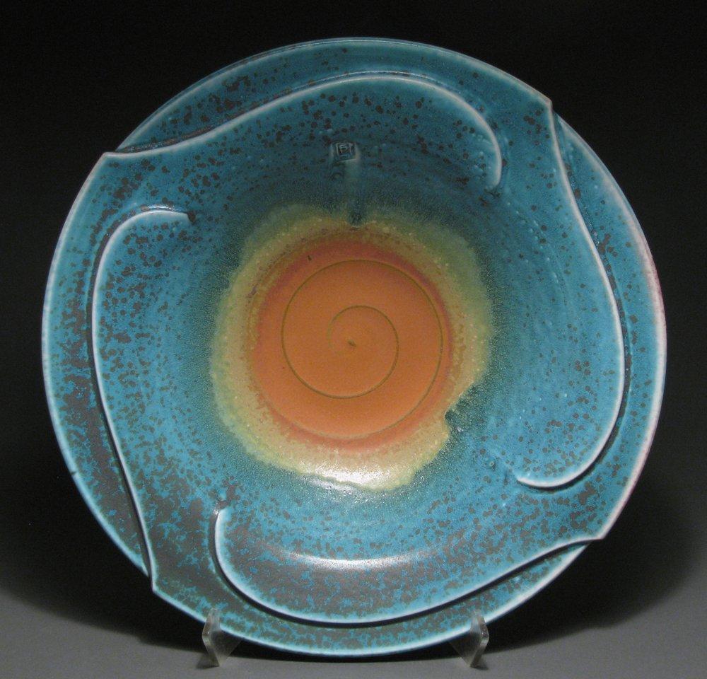 """Pinwheel bowl  17"""" diameter  Glazes: matte turquoise and matte rust"""