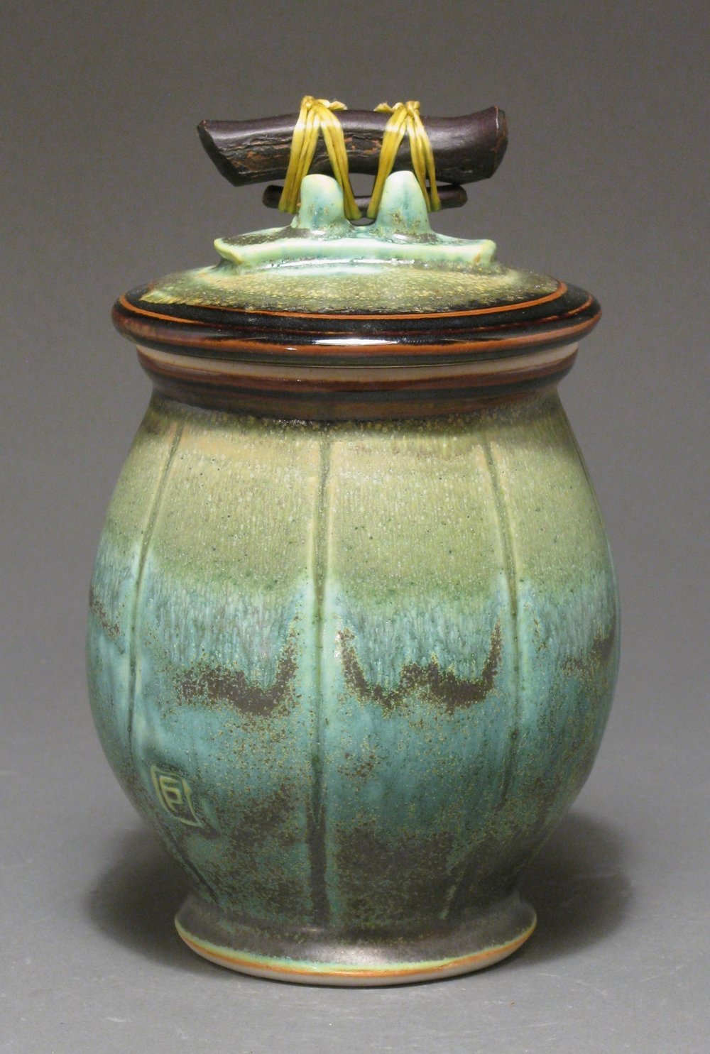 "Lidded jar  7"" tall  Glazes: Patina green and temmoku"
