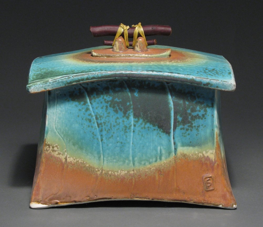 "Lidded box  7"" tall by 7 3/4"" long by 5 1/4"" wide  Glazes: matte turquoise and matte rust"