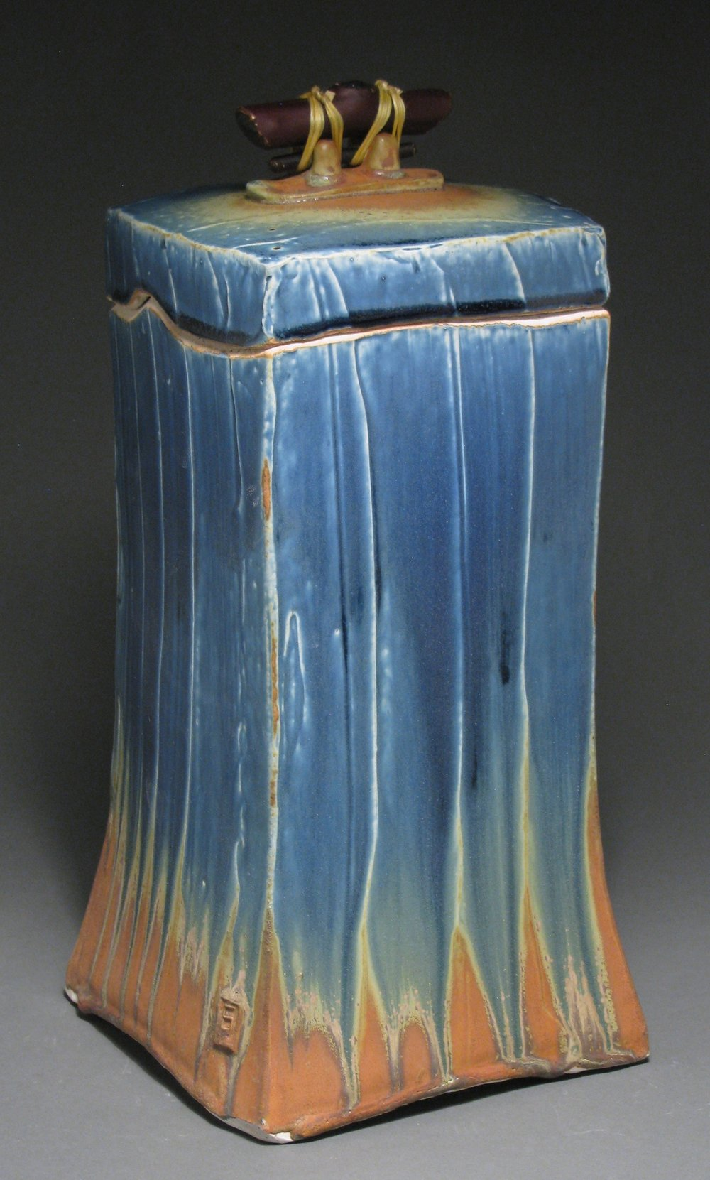 "Lidded box or funerary urn  13 1/4"" tall by 6 1/4"" deep by 6 1/4"" wide  Glazes: Mixed blue and matte rust"