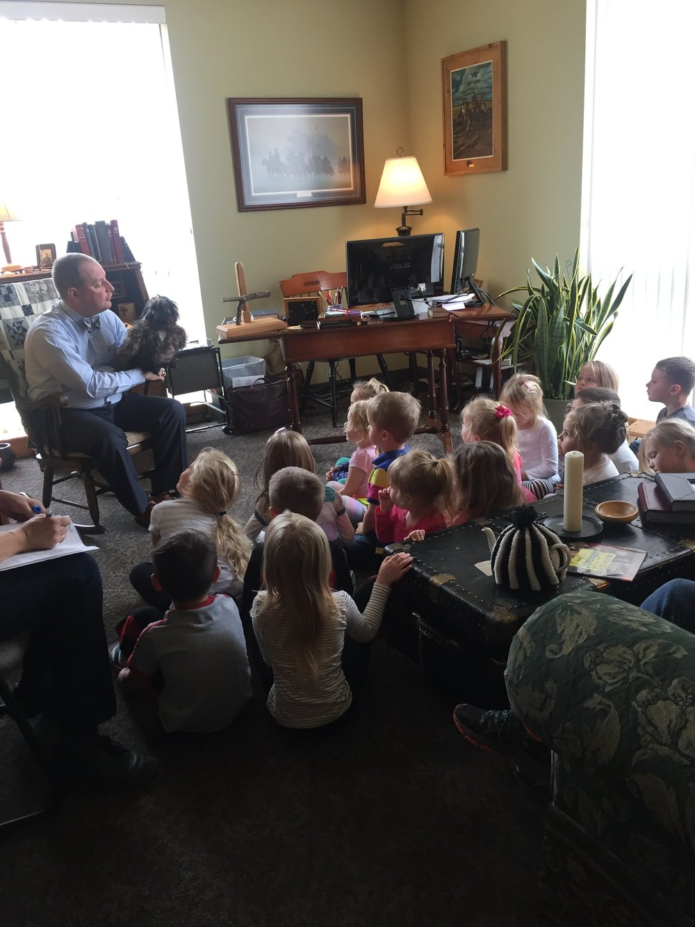 Pastor Walt regularly reads Bible stories to children.