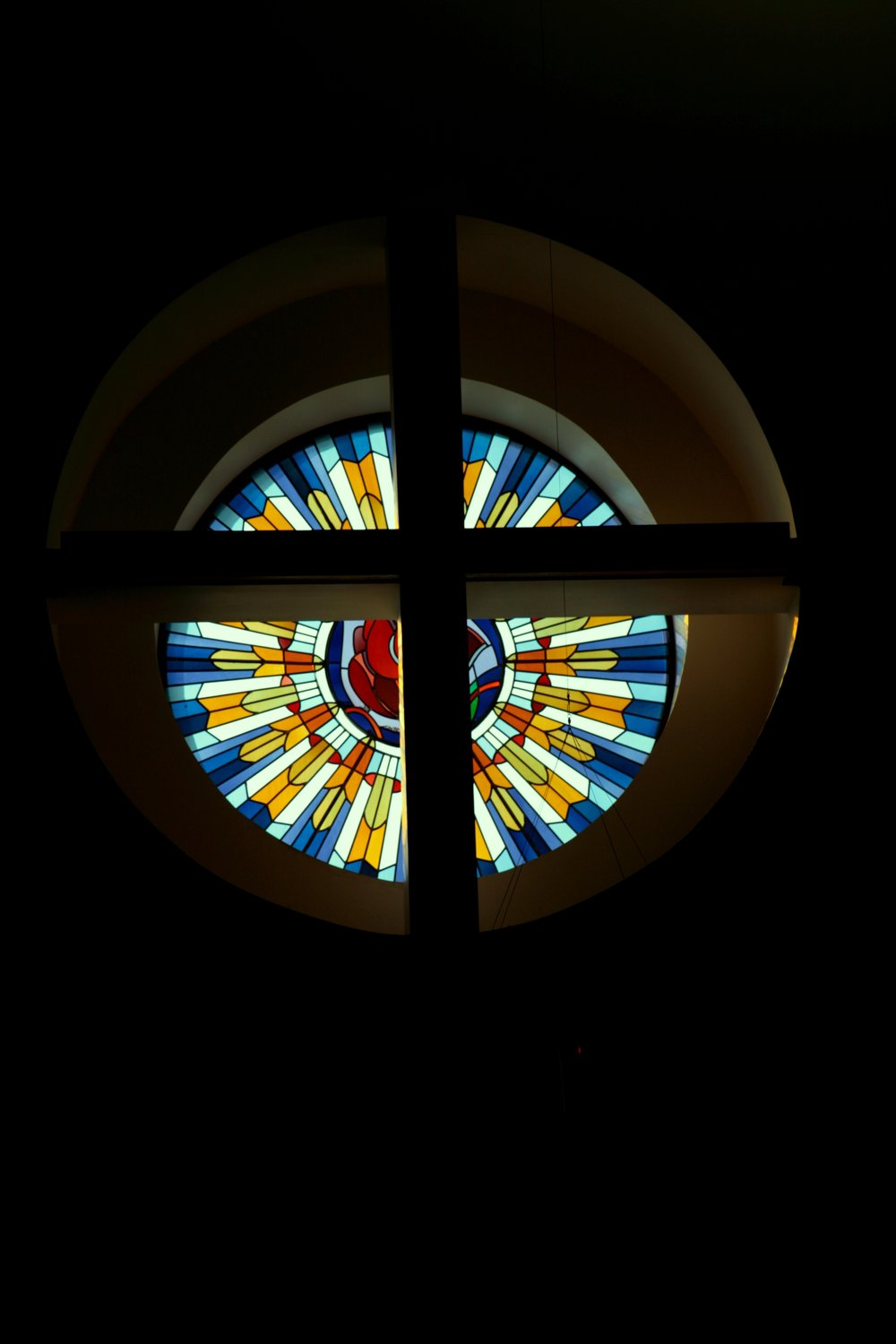 The rose stained glass window in the sanctuary, reminds us of Christ's love shining through.