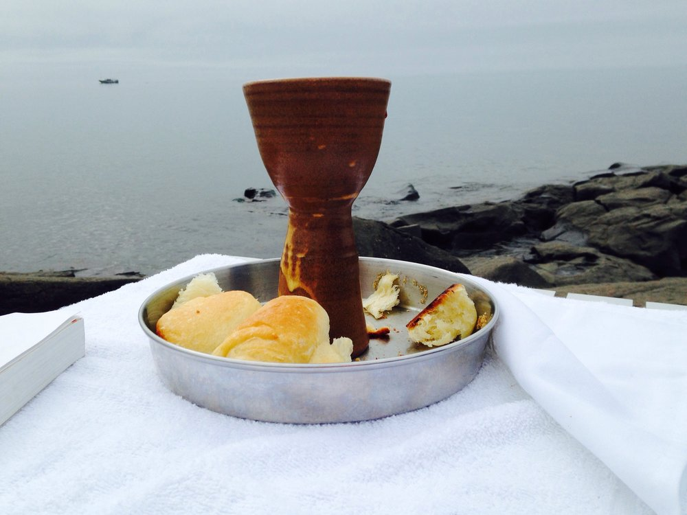 Celebrating Eucharist on the shore of Lake Superior during Family Camp