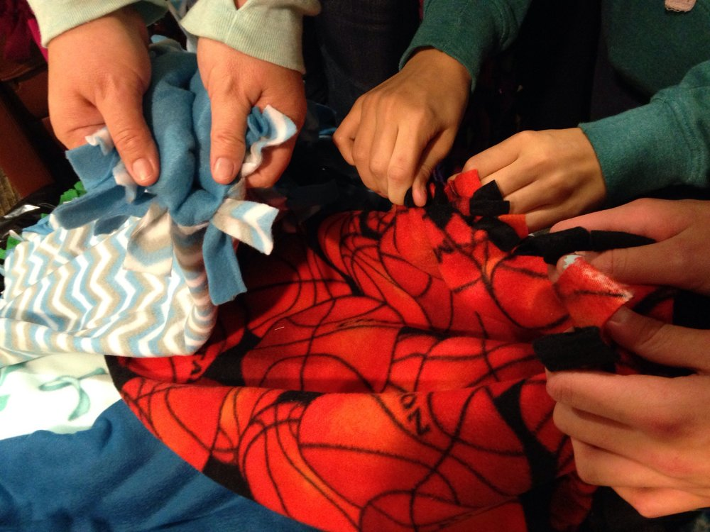 Confirmation students tie blankets for hospitalized children