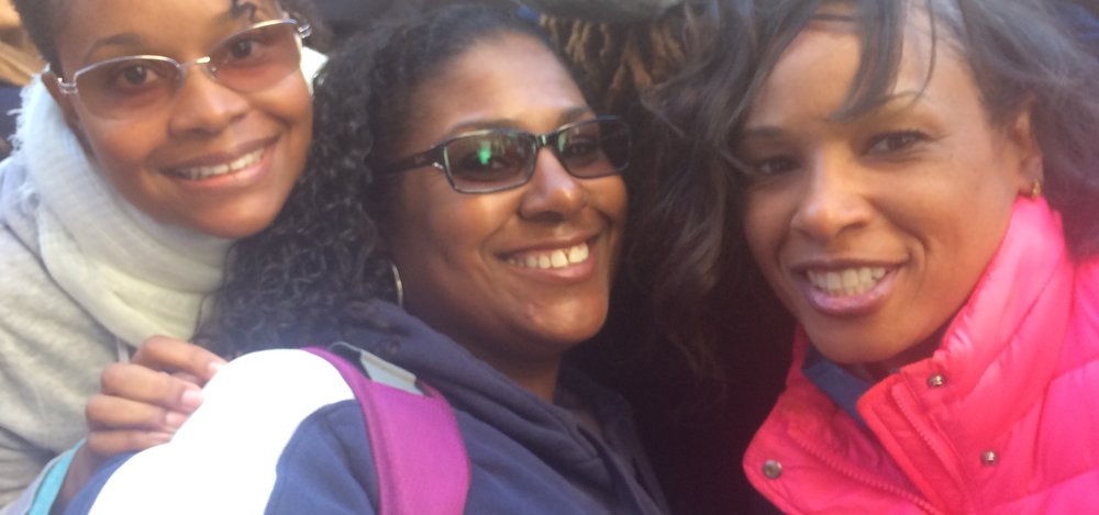Dawn Jones (center) and friends were all smiles for the march, as well as the struggles ahead. (Photo by Loud Owl)