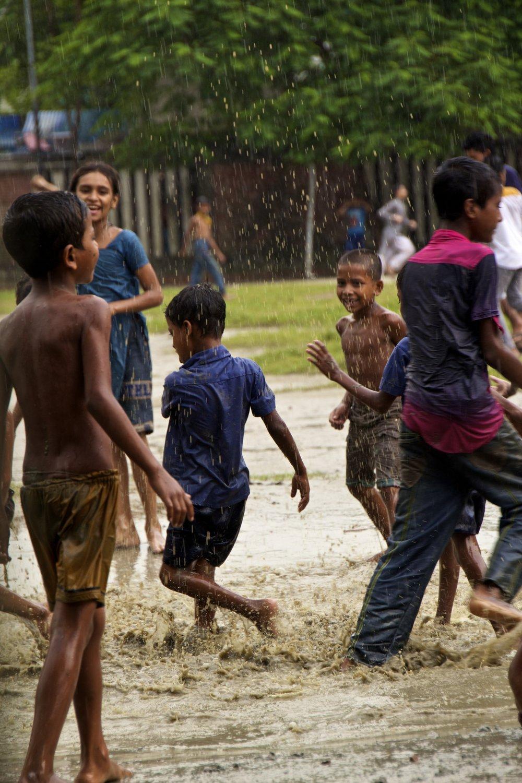 dhaka bangladesh children play in the rain 1.jpg