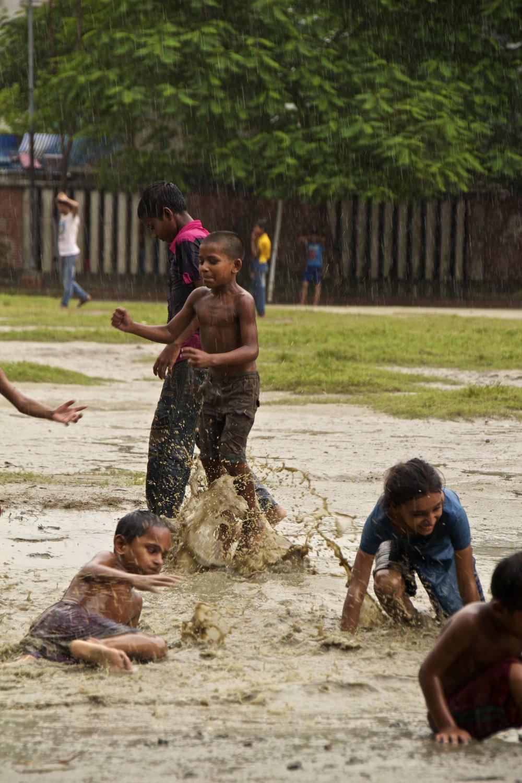 dhaka bangladesh children play in the rain 2.jpg