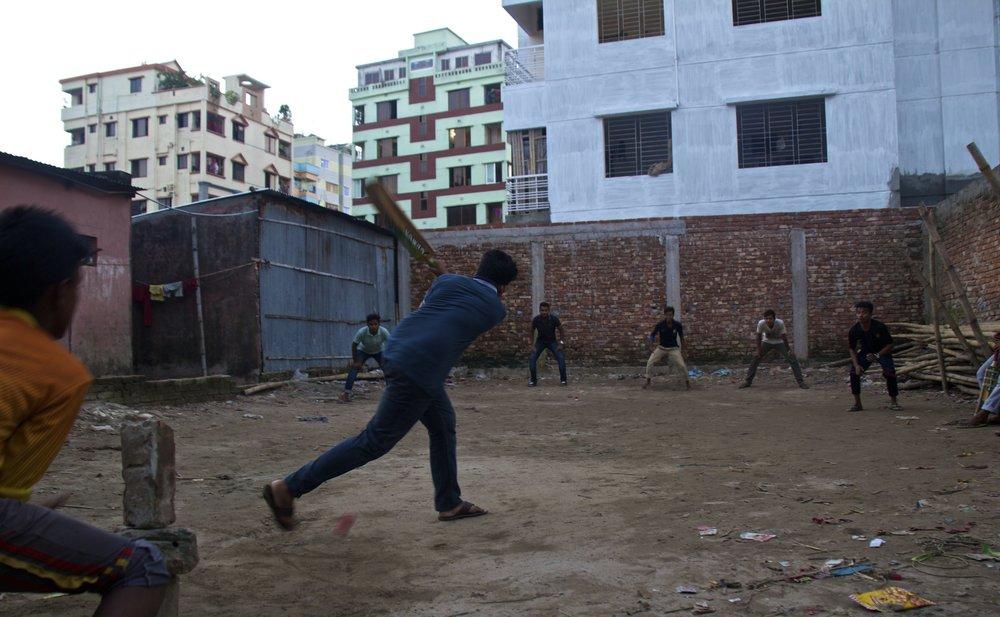 rayer bazar dhaka slums playing cricket 5.jpg