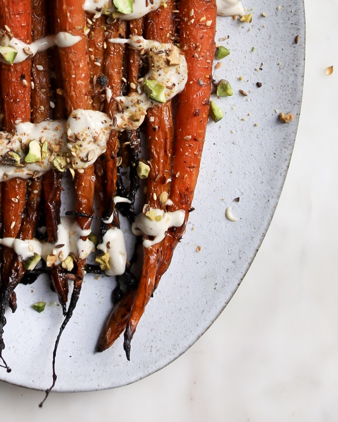 Dukkah should have a varied texture. Carrots should be crispy at their edges.