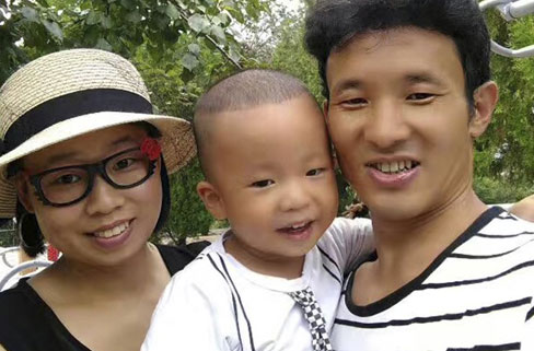 In this photo taken in 2016 and released by Deng Guilian, she, her husband Hua Haifeng and their son Bo Bo pose for a photo.