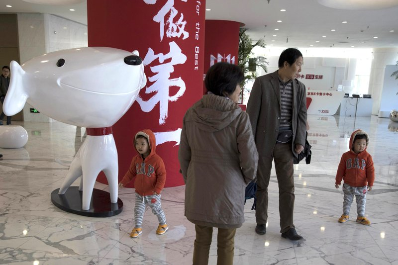 "In this Nov. 11, 2017 file photo, young children visit the headquarters for Chinese e-commerce giant JD.com during ""Singles Day"" in Beijing, China. (AP Photo/Ng Han Guan, File)."