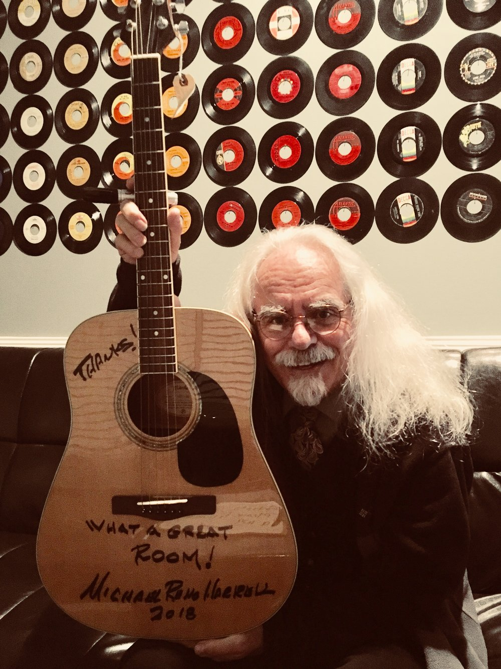Michael Reno Harrell in the green room with his signed guitar.