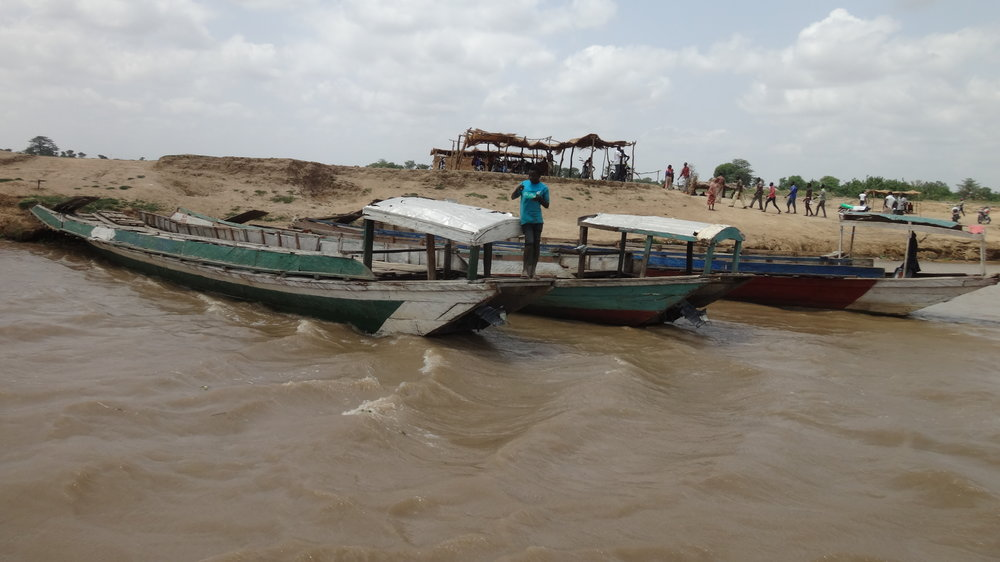 The ferry docks at Lau, Taraba State, Nigeria.  Benue River.