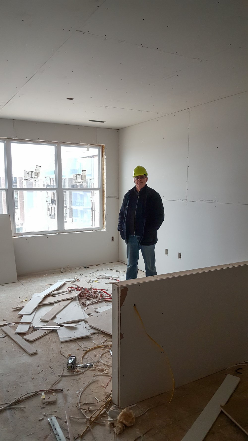 Mark Bruzan inspects drywalled room