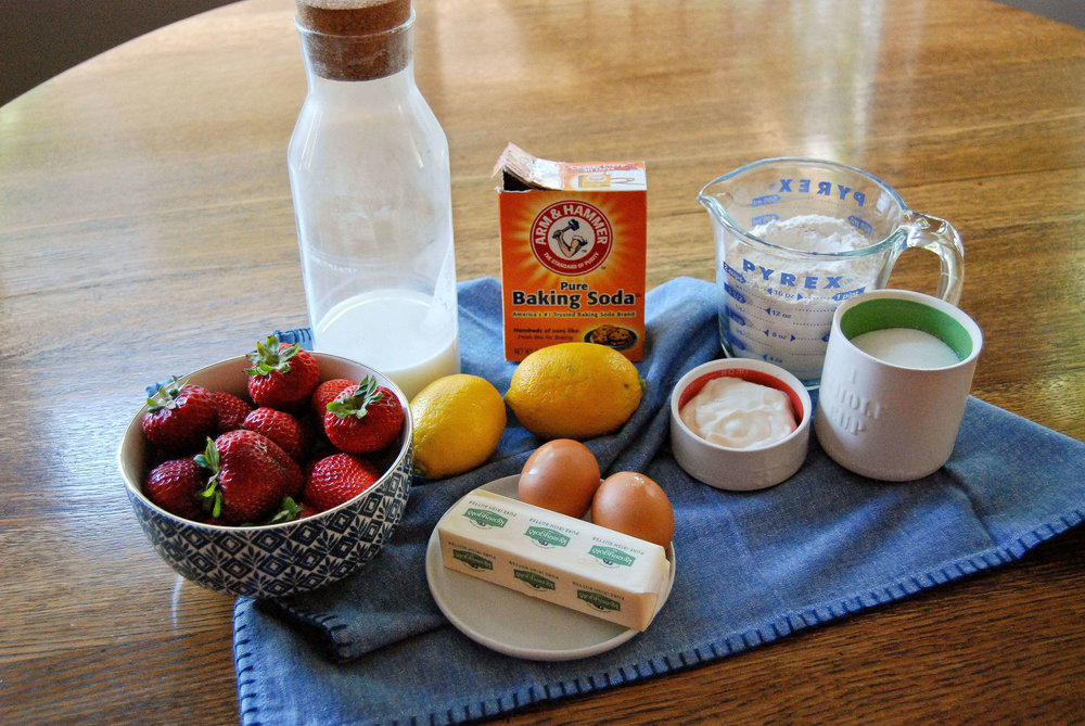Lemon And Strawberry Cake Ingredients On Wood Table
