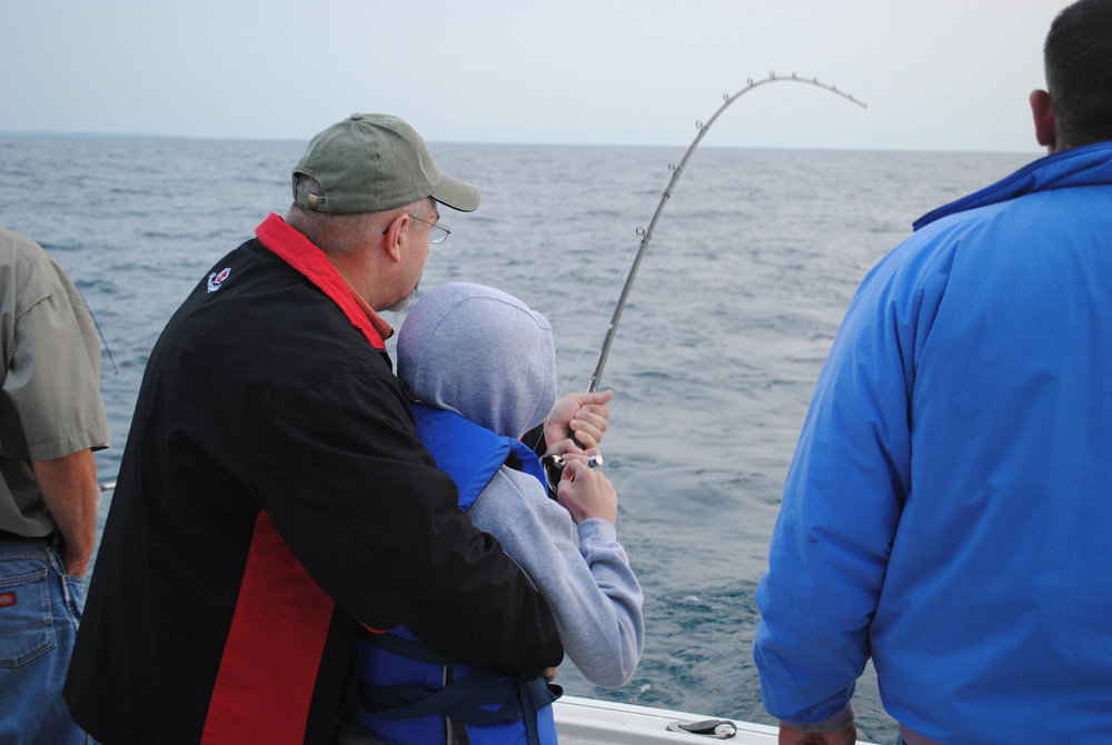 Grandfather and Grandson Lake Michigan Fishing Charter