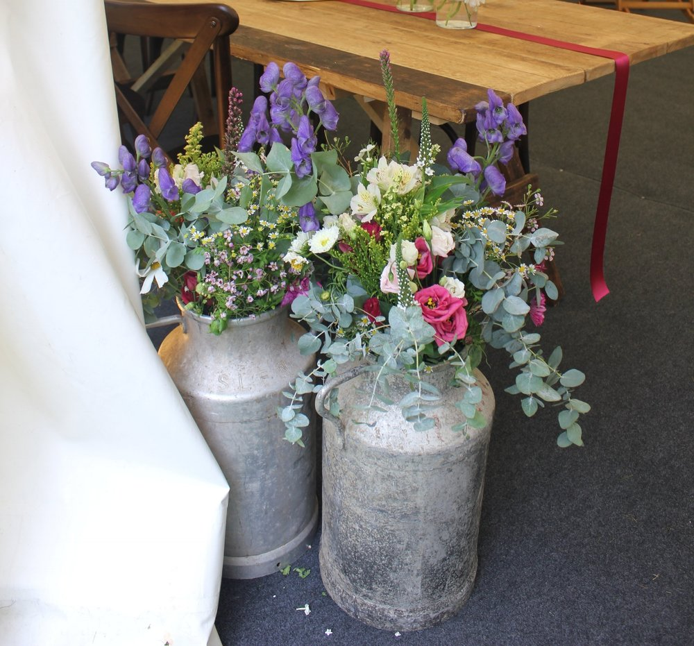 Stunning vintage milk churns perfect for all garden parties, celebrations & weddings. 5 available